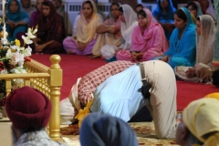 "Mourners pray for their neighbors killed in an attack the day before on a Wisconsin Sikh temple on August 6, 2012 in Brookfield, Wisconsin. Hundreds of mourners gathered at the Sikh Religious Society of Wisconsin -- a temple just 25 miles (40 kilometers) from the scene of the August 5 bloodshed -- to honor the six people killed and three critically wounded in what police are calling a ""possible domestic terrorism"" case.    AFP PHOTO / MIRA OBERMAN        (Photo credit should read MIRA OBERMAN/AFP/GettyImages)"